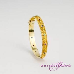 Armreif 18 Karat Gold mit Saphir, Rubin und Smaragd