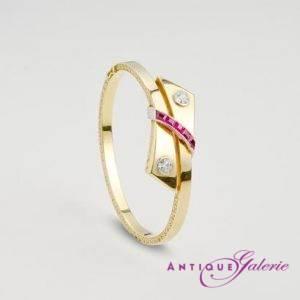 Armreif 18 Karat Gold mit Brillant und Rubine